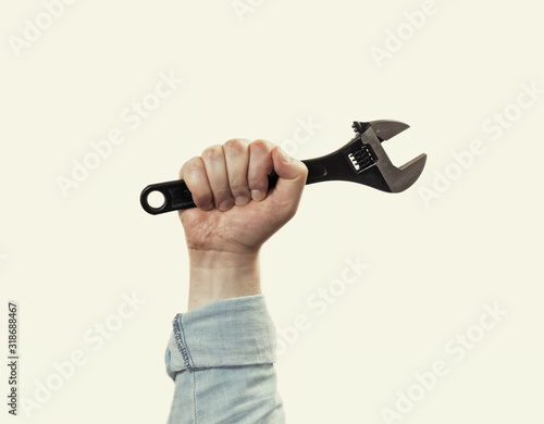 Fototapeta Male hand with black wrench. Concept of technical support. On isolated background. Image obraz