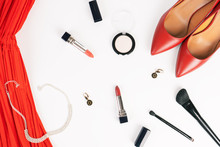 Flat Lay Feminine Clothes And Accessories Collage With Red Dress, High Heel Shoes, Necklace, Earrings, Lipsticks, Makeup Brushes, Eye Shadow