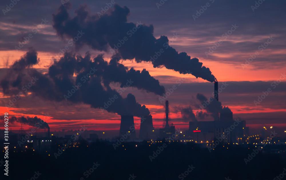 Fototapeta Sunrise over a power plant
