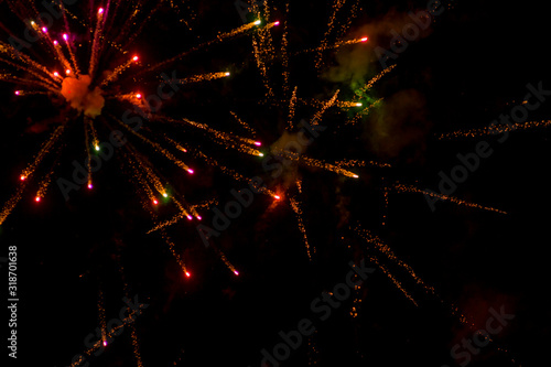 Fototapeta Fireworks in a dark night sky