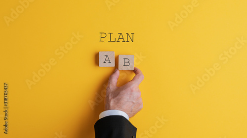 Businessman choosing plan B Canvas Print