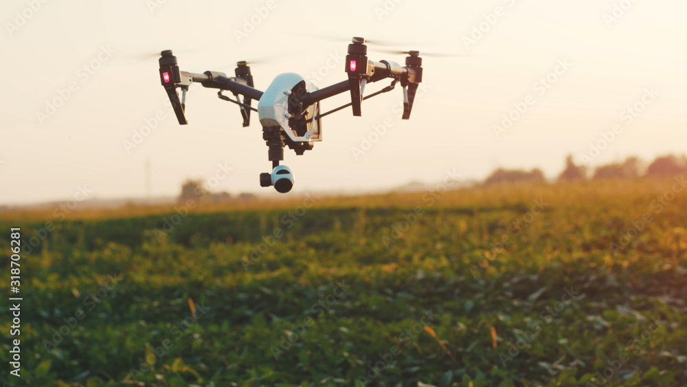 Fototapeta Close up smart agriculture drone flying in sky rural aerial helicopter agros copter farm farming field industry landscape meadow nature plant professional vehicle harvest innovation slow motion