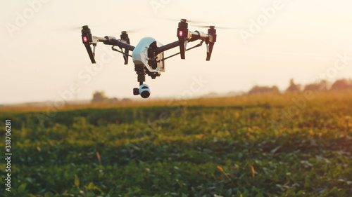 Fototapeta Close up smart agriculture drone flying in sky rural aerial helicopter agros copter farm farming field industry landscape meadow nature plant professional vehicle harvest innovation slow motion obraz
