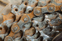 Close-Up Of Rusty Bicycle Chain In Industry