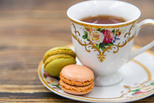 Cup Of Tea With Macaroons On W...
