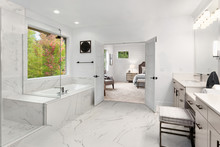 Master Bathroom Interior In New Luxury Home With Marble Floors And Wall Accents. Shows View Of Master Bedroom