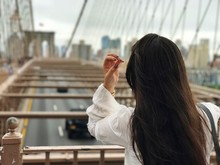 Rear View Of Woman With Long Hair In City