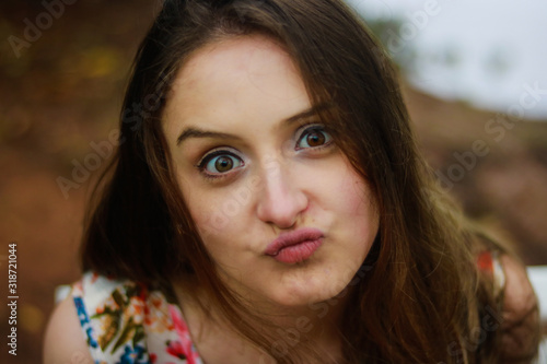 Valokuva Close-Up Portrait Of Young Woman Puckering Lips
