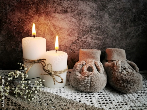 Two burning candles on a dark background.