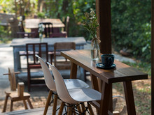 Empty Chairs And Table At Restaurant