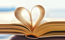 Open Book With Heart Shaped Pa...