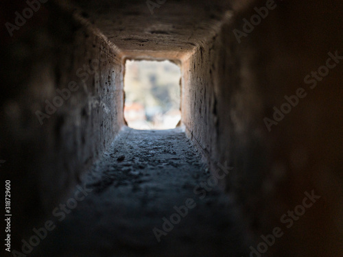 Photo Look through the inside of rectangle brick hole in different perspective and aff