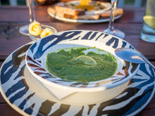 CLOSE-UP OF Spinach Soup IN PLATE ON TABLE