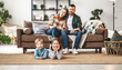 canvas print picture happy family mother father and kids at home on couch .