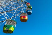 Ferris Wheel On Clear Blue Sky...