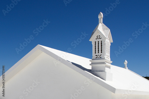 Tablou Canvas High Section Of White Building Against Clear Blue Sky