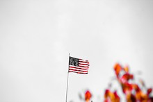 Low Angle View Of American Flag Waving Against Clear Sky