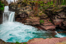 Rushing Waters Of Saint Mary Falls At Glacier National Park