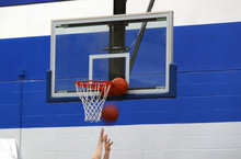 A Basketball Gets Stuck Between The Rim And Backboard