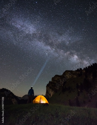 Man Standing On Field Against Sky At Night - fototapety na wymiar