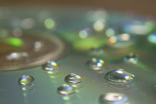 Closeup Of A CD With Water Dro...