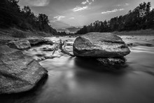 Grayscale Shot Of A Rock In Th...