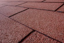 Closeup Of Red Tiles Under The Sunlight With A Blurry Background