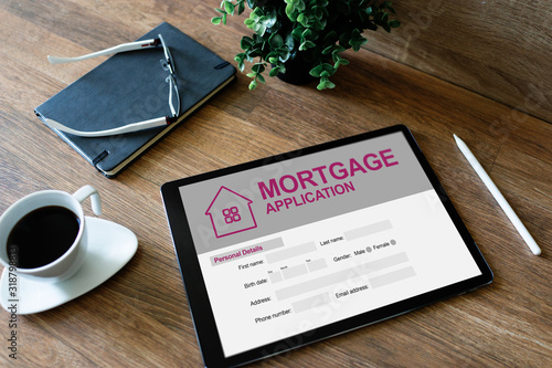 Online mortgage application on screen. Property loan. Business and financial concept.