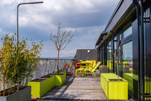 Green And Terracotta  All-season Weatherproof Furniture For Outdoor Use On A Rooftop Terrace .