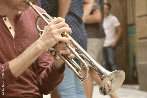 Midsection Of Man Playing Trumpet Wallpaper Mural