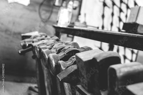Fotografie, Obraz Close-Up Of Hammers At Blacksmith Shop