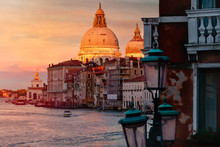Santa Maria Della Salute And Buildings By Canal Against Cloudy Sky During Sunset