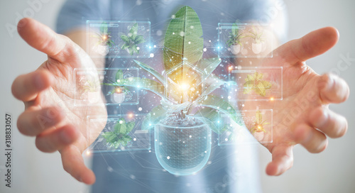 Photo Man holding and touching holographic projection of a plant with digital analysis