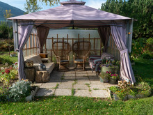 Gazebo In The Garden With Sofa...