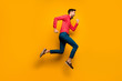 Full length profile photo of crazy funny guy jumping high up rushing black friday shopping wear trendy red shirt bow tie pants shoes outfit isolated yellow color background