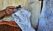 Midsection Of Man Making Batik