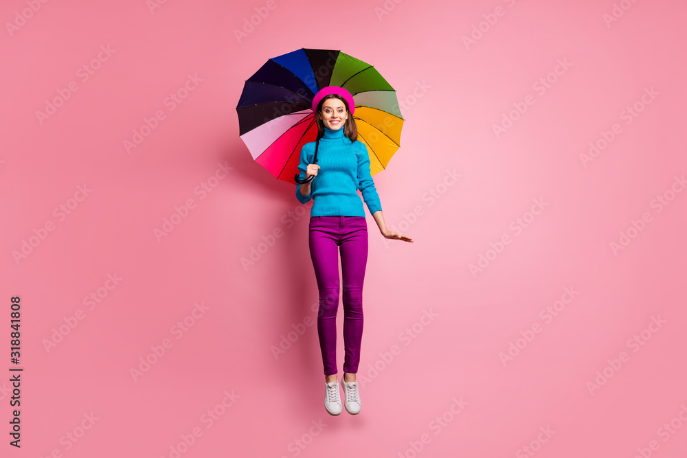Obraz Full length photo of girlish charming girl jump have relax walk on rainy season fall weather hold bright umbrella wear good look outfit isolated over pink color background fototapeta, plakat