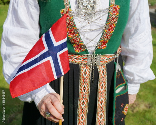 Obraz Midsection Of Woman Wearing Traditional Clothing While Holding Norwegian Flag - fototapety do salonu