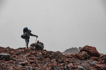 Tourist Stands On Rocks In Sno...