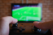 Bangkok, Thailand - January 22, 2020: Photo Of Playing  FIFA Online Football Video Game From Nintendo Switch Console. Close-up Shot Of Fingers Throwing Joystick In Home. Indoor Entertainment.