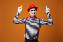 Happy Mime In Red Hat And Vest Showing Thumb Up On Orange Background