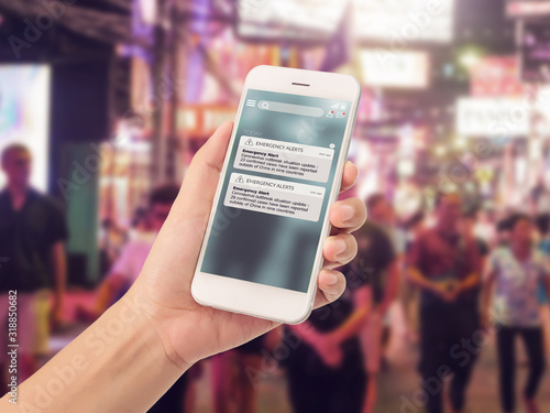 Obraz warning alert sms via smart phone for infective outbreak situation on phone screen. catastrophic situation news update system for people - fototapety do salonu