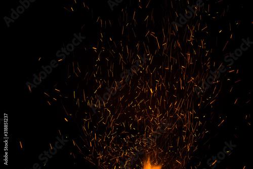 Fotomural Sparks Over Black Background