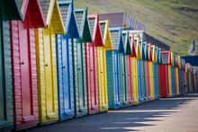 Multi Colored Huts On Road Aga...