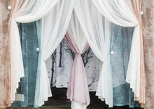 Curtains And Tulle In A Modern Interior. Various Decorative Fabric Materials For The Home. Modern Vision Of Style. The Combination Of Colors And Aromas. Decoration Of Windows In The Room