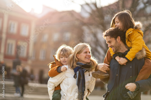 Fototapeta Affectionate young family enjoying their day in a city obraz