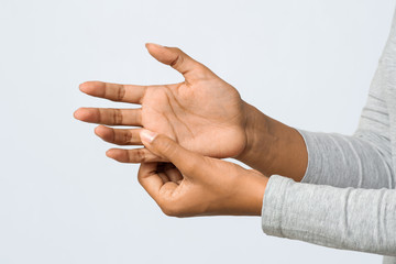 Close up of woman hand with numb finger syndrome