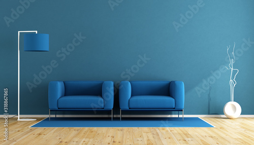 Empty Chairs And Electric Lamp Against Blue Wall At Home - fototapety na wymiar