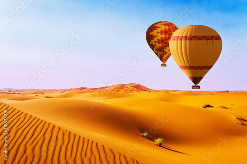 Obraz Balony  desert-and-hot-air-balloon-landscape-at-sunrise-travel-inspiration-success-dream-flight