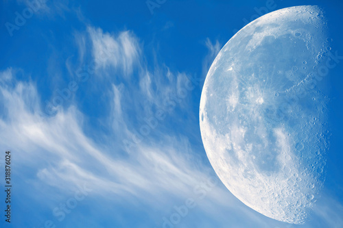 Fototapeta księżyc   blue-sky-with-beautiful-clouds-the-moon-with-a-large-increase-against-the-background-of-clouds